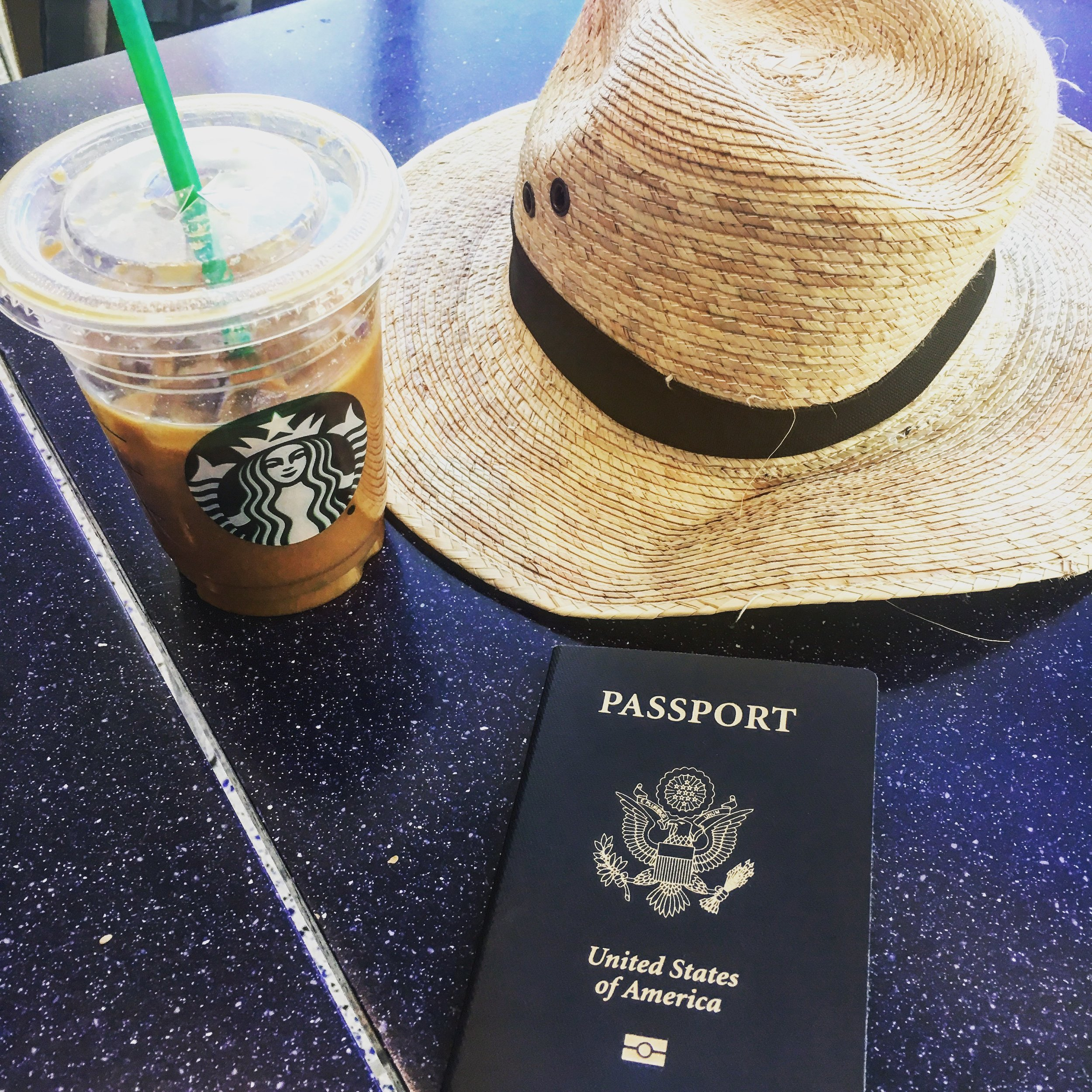 My ideal airport setup - chilling with a beverage, passport easily accessible, not rushing.