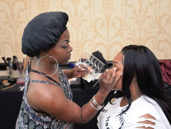 Vanetria working her magic on one of her beautiful clients