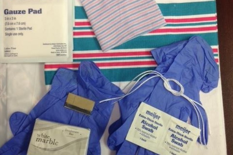 Clean birth kit for mothers. Includes: gloves, sterile string for cord, razor blade, soap, gauze, blanket and hat.