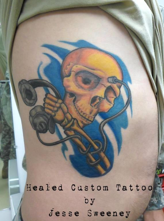 Skull with Headphones tattoo