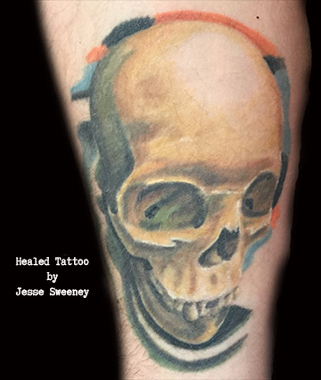 Painterly skull tattoo