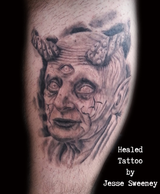 Realistic devil tattoo by Jesse Sweeney