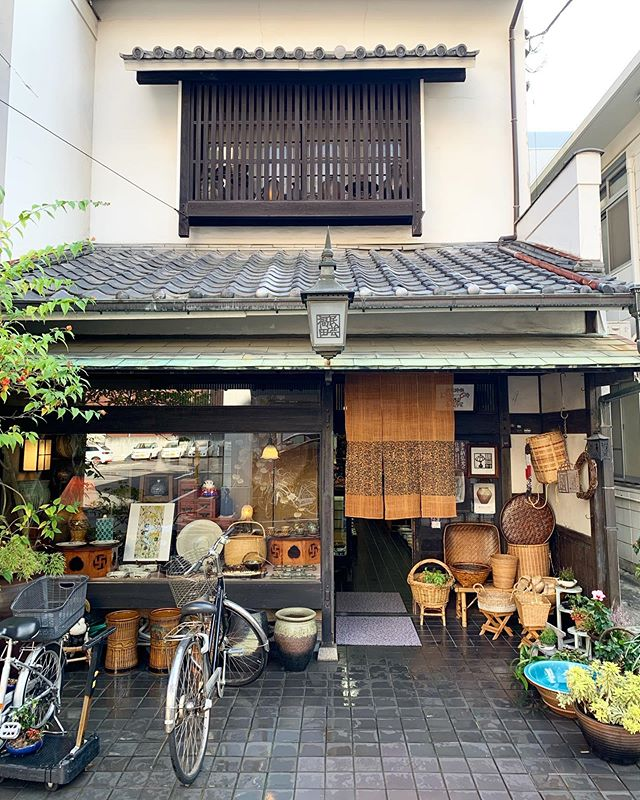 """Hello from Shikoku! I stumbled on this great antique store, Mingei Fukuda, this afternoon. Downtown Takamatsu has an eclectic selection of old and new shops, including one of the longest covered shopping streets (""""shotengai"""") in Japan. It offers a great window into Japanese life! I'm excited to meet our tour group tomorrow! . . #traveldeeper #travelwithfathom #suitcasetravels #mytinyatlas #shikoku #takamatsu #bbctravel #guardiantravelsnaps"""