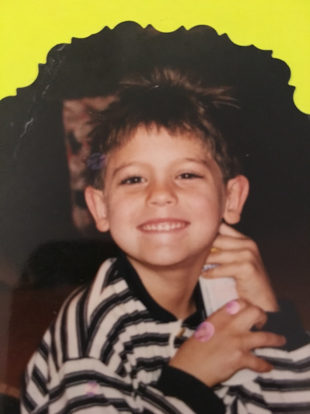 John, the cute kid with the long eyelashes, around the time he came to live with the Lindstroms.