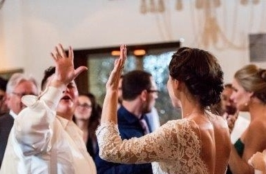 John and Chrissy dancing at her wedding.