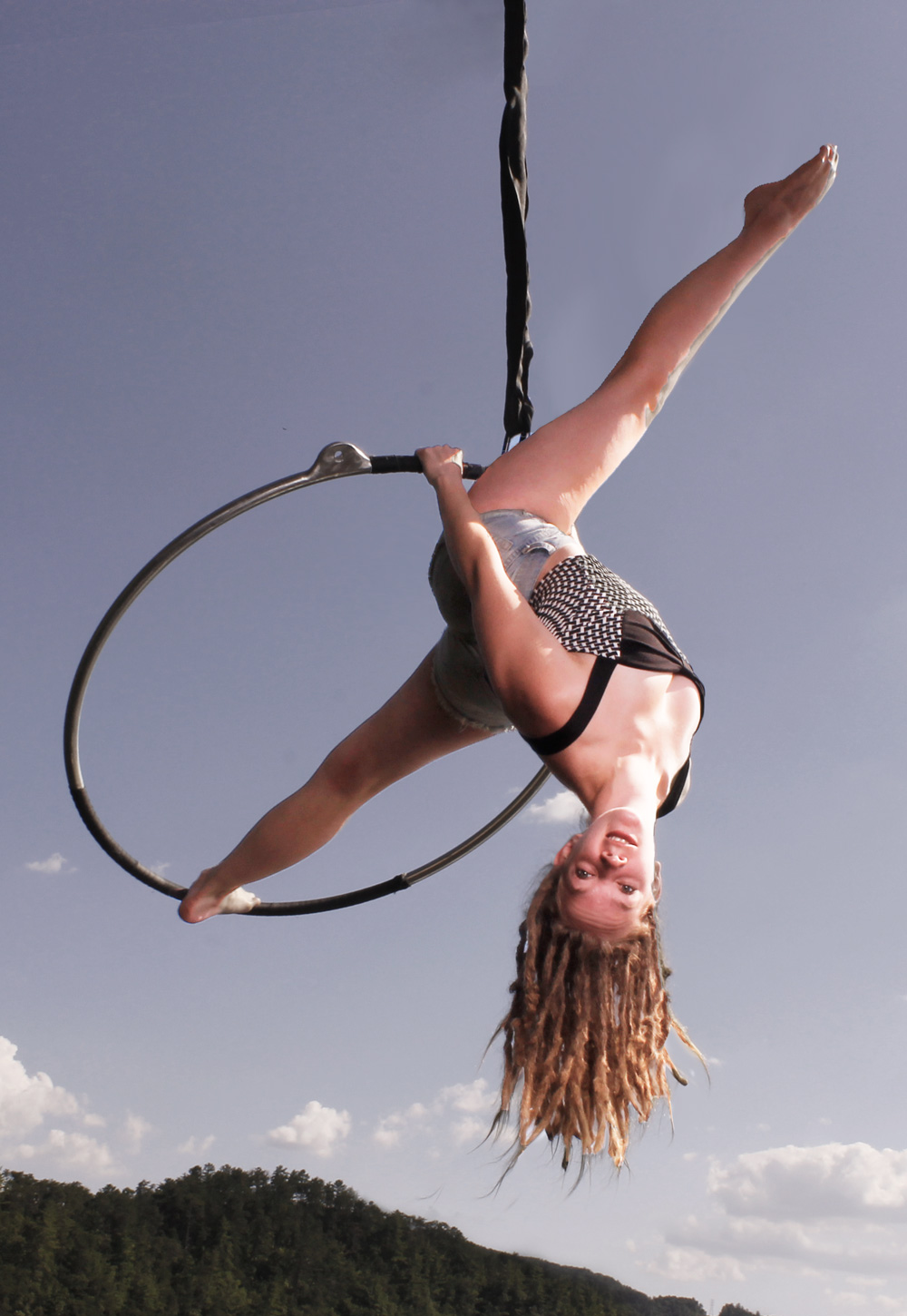 Aerial Dance:  Flying entertainment? Nova is competent on all popular aerial apparatus, including Lyra  (shown above) , silks, hammock, and trapeze.