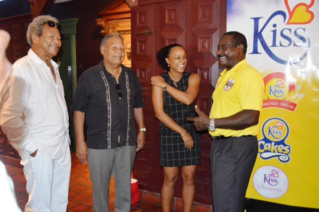 Earl Lovelace, Alvin Corneal (T & T Football Legend), Maylee Attin Johnson ( National Women's Footballer) and Gally Cummings in joyful conversation at the GFFS launch.