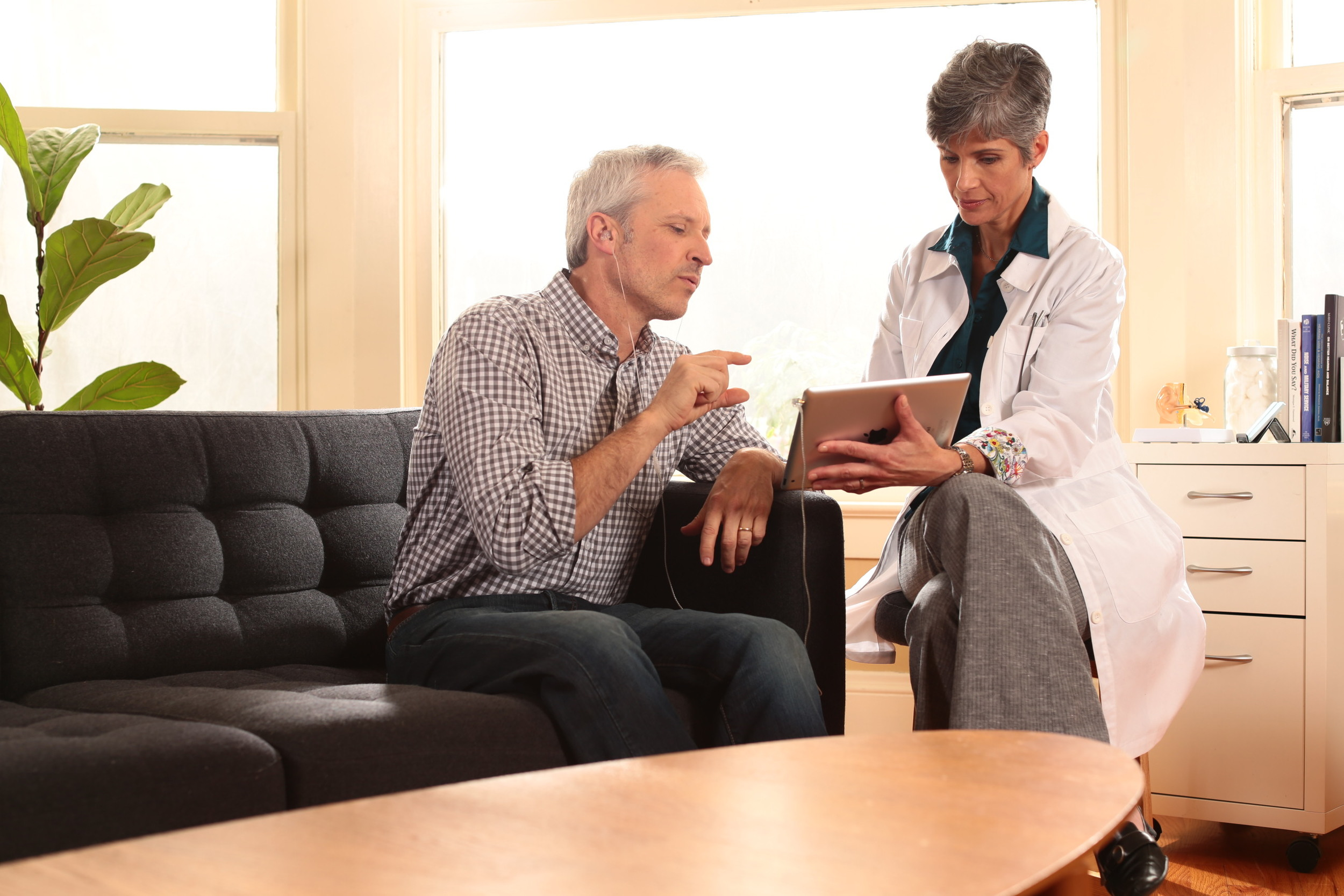 Patient and hearing professional using the Levo System for tinnitus sound therapy