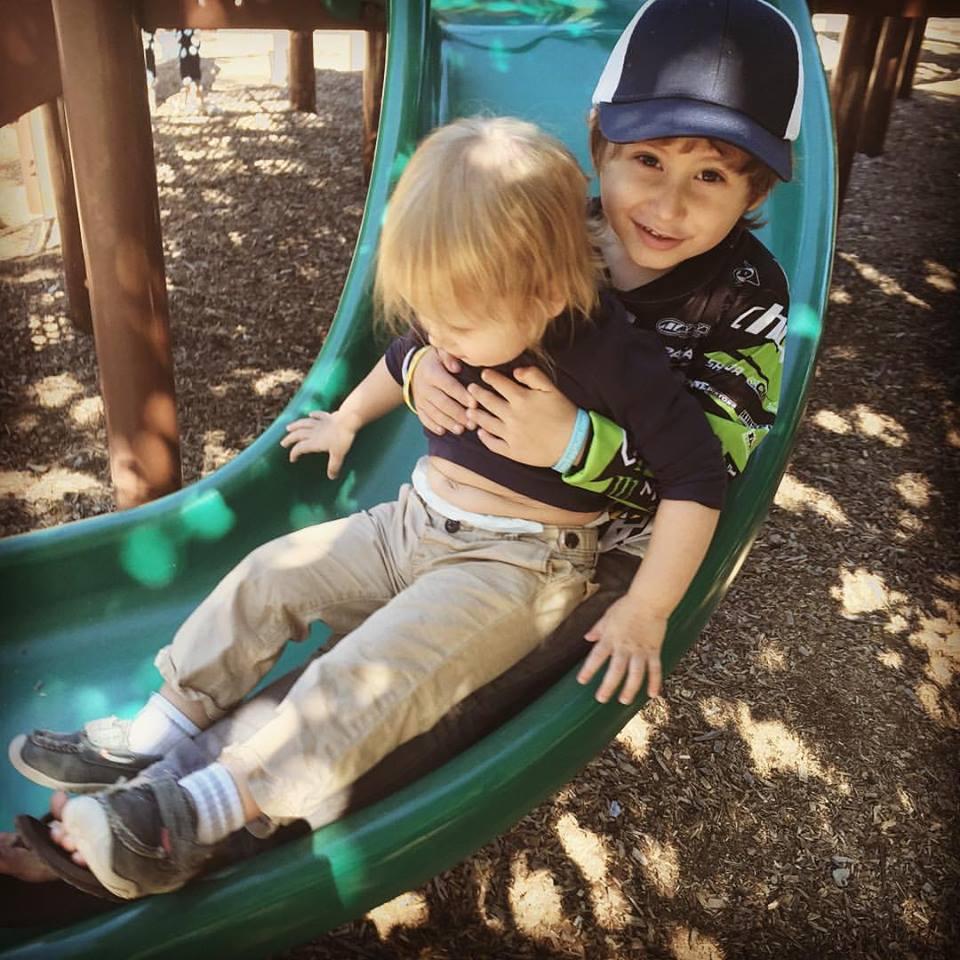Slide with boys.jpg