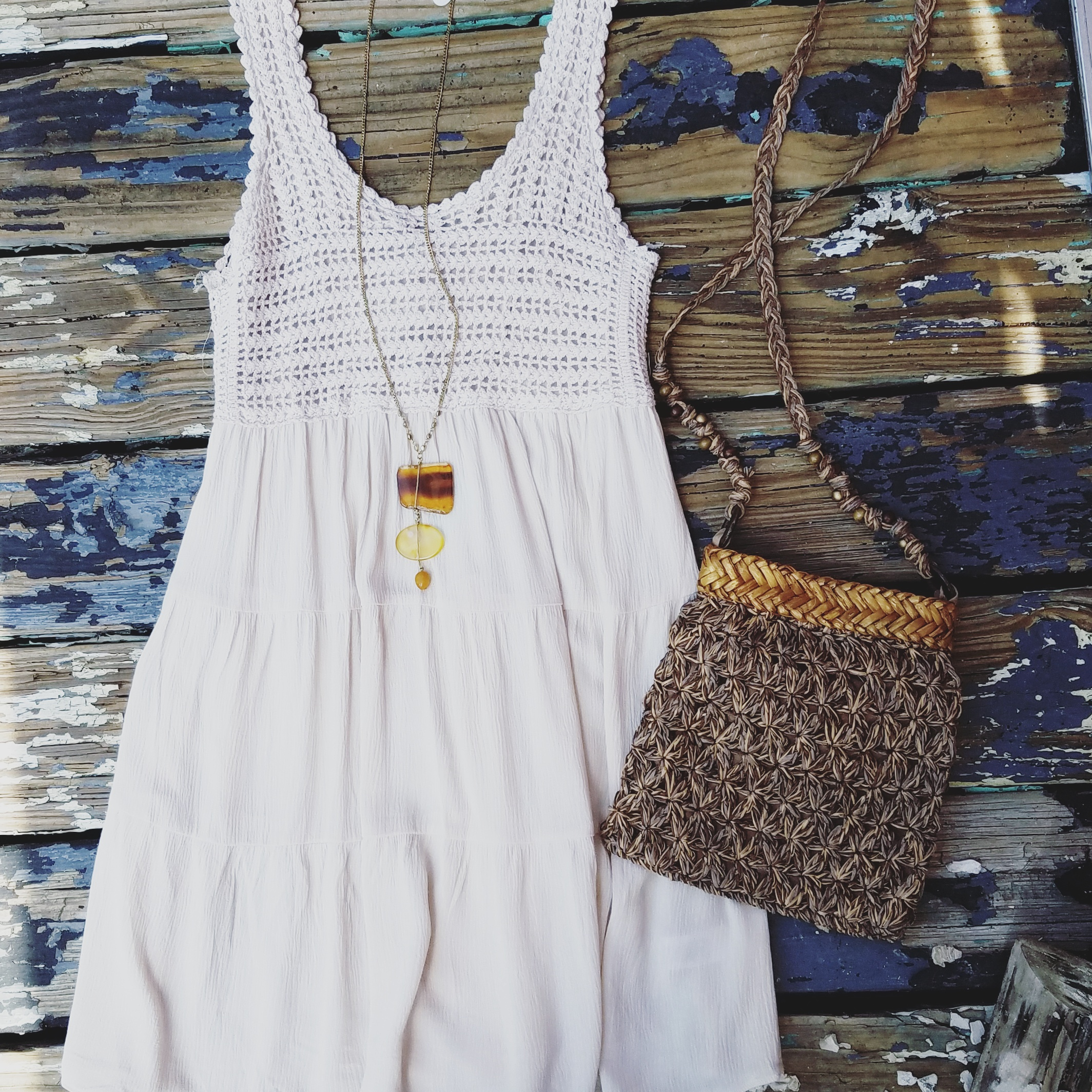 This sweet dress has us swooning! Perfect for a day on the beach or exploring the city. Pair with a straw cross-body bag and natural stone necklace to complete the look.