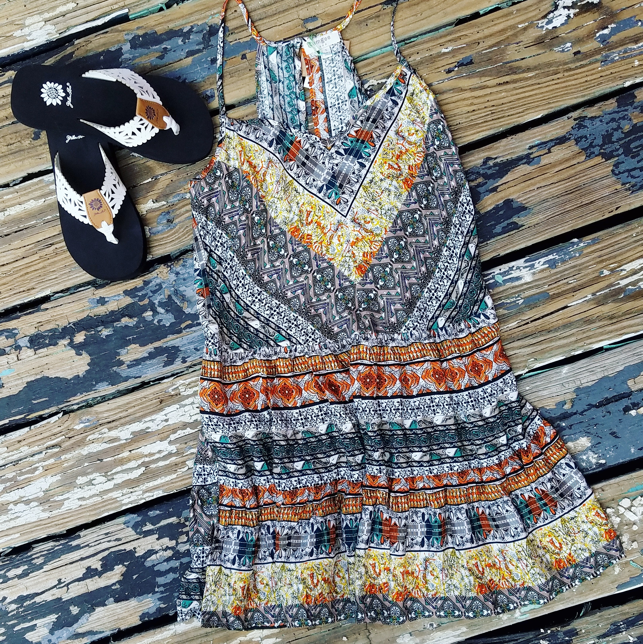 You can't go wrong with a bright and patterned sundress with flip flops. This dress is light and breezy to keep you cool even on the hottest of days. Pair with our favorite summer flips flops from YellowBox.