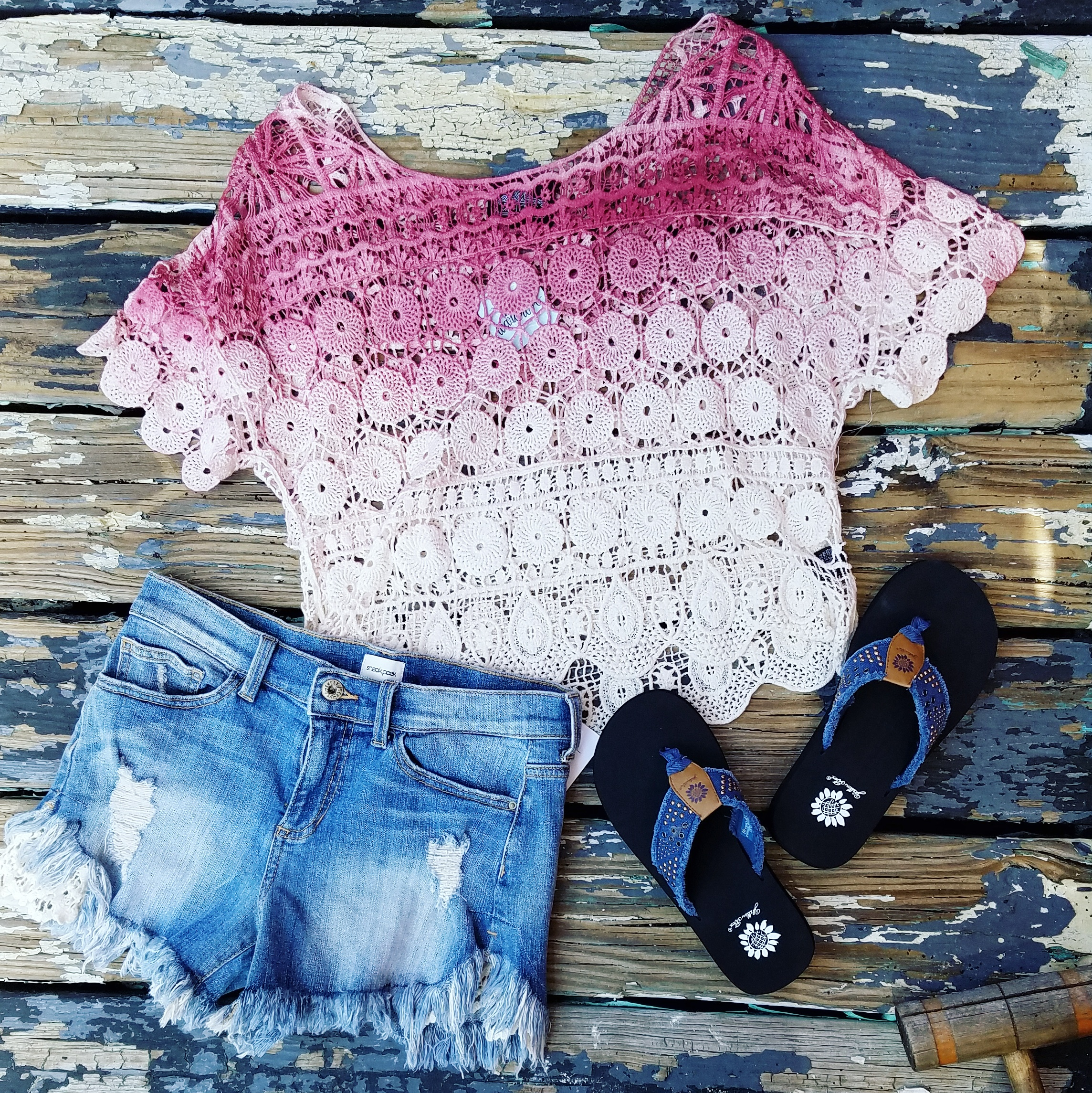 Everyone needs a good pair of cutoffs! If you haven't tried on a pair of Sneak Peek jeans yet, you MUST! Pair with this crocheted top over a bandeau and throw on your favorite sandals.