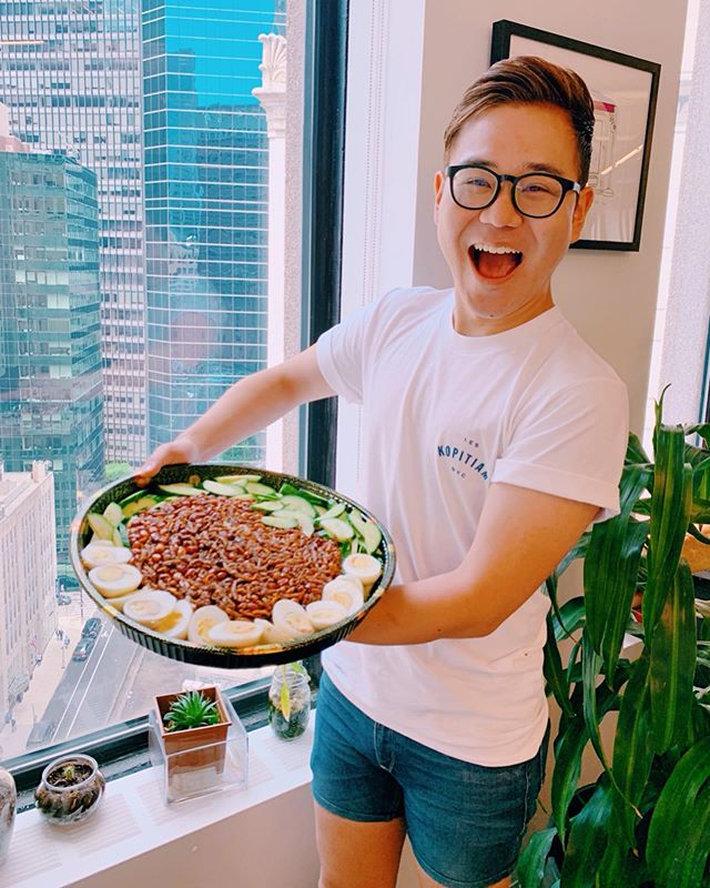 😍When your nasi lemak dream comes true😭 thanks to ✨@kopitiamnyc and @moonlynntsai✨⁣ ⁣ When @moonlynntsai said, she would bring some Nasi Lemak to the @eater office today, I HAD NO IDEA that SHE WOULD BRING ME THIS GIANT NASI LEMAK THAT GOT ME SHOOOOK🤩😱⁣ ⁣ If you were there, I was SHAKING😂 You know that feeling that you never knew that you needed it, but once you see it, you can't stop thinking about it? That's this GIANT nasi lemak😻⁣ ⁣ And, NO. I didn't eat this whole thing by myself 🙈(I'm not a MONSTER. Maybe anchovies and coconut rice, but over 14 boiled eggs might be a stretch for me🙅🏻‍♂️)⁣ ⁣ BUT once again, thank you for making my nasi lemak dream come true, and I love you so much @kopitiamnyc❤️⁣ ⁣ STAN GOOD FOOD. STAN GOOD PEOPLE. STAN KOPITIAM. (SO GET THEIR MERCH!)⁣ ⁣ Thank you @bycarlavianna for capturing my happy nasi lemak moment🥰