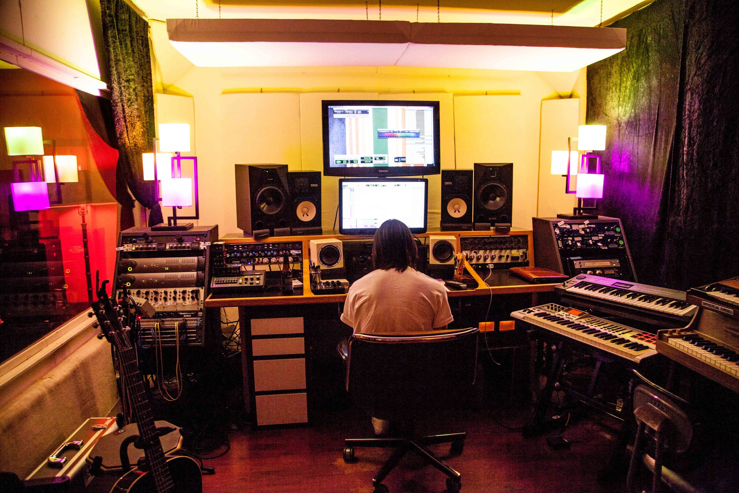 Listening to a mix at Melrose Recording Room. Photo by Genevieve Adams