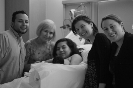 Marlee and Megan (far right) with new parents, their baby, and their midwife