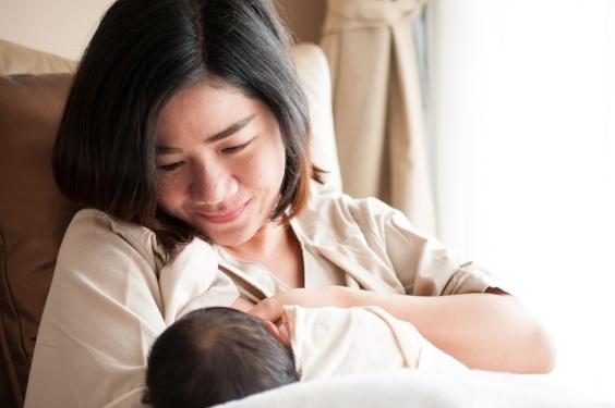 New parent nursing newborn Long Beach breastfeeding support