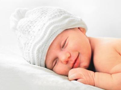 Baby smiling in sleep Costa Mesa doula