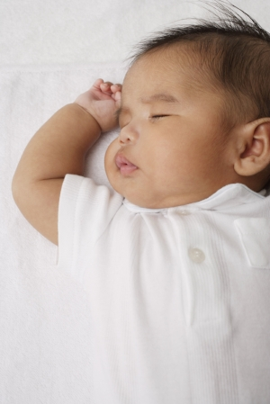 Peaceful sleeping baby Orange doula