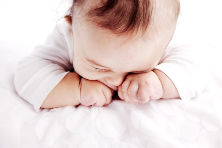 Sleep baby rubbing eyes Irvine sleep training
