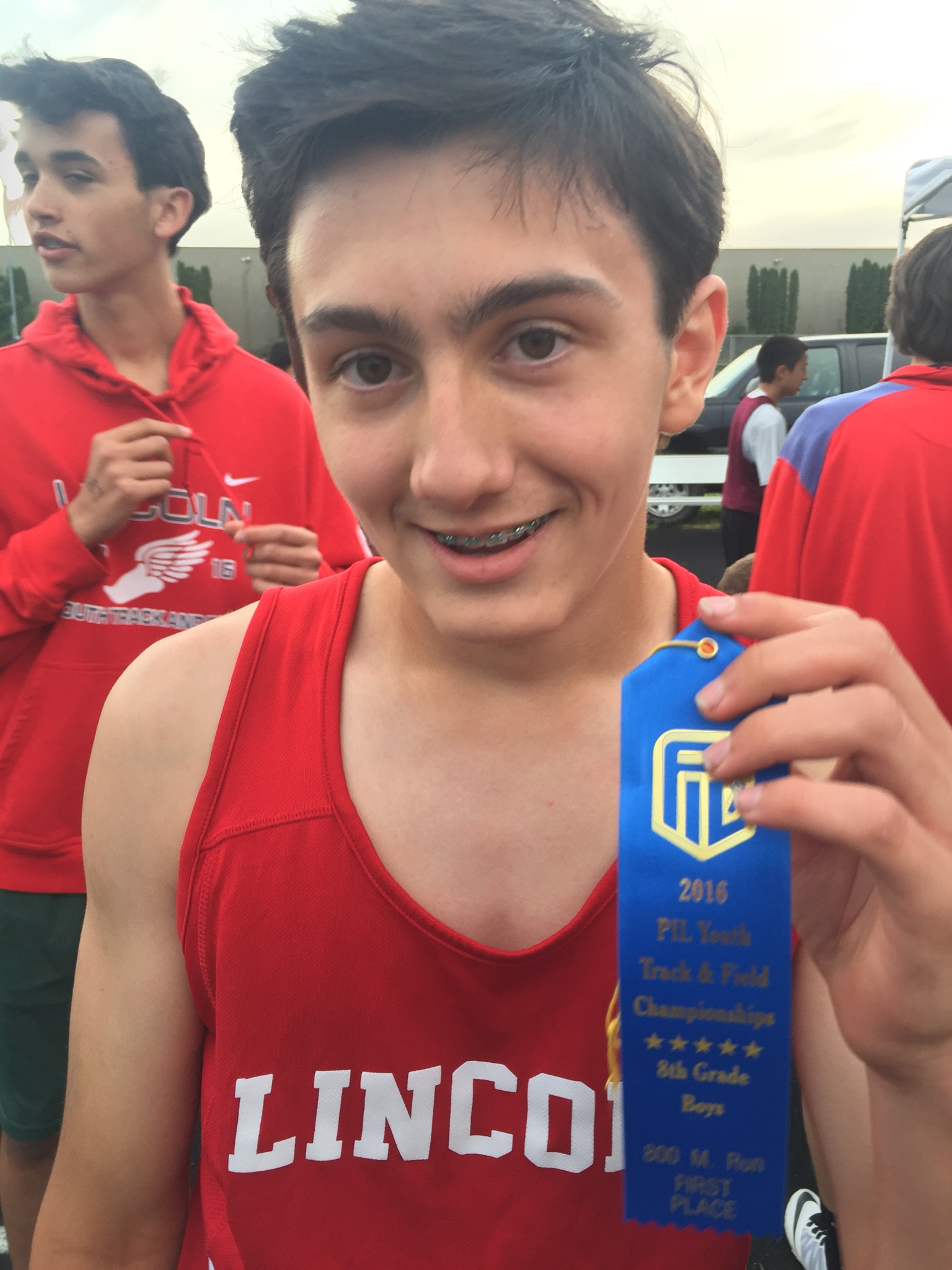 Ethan holding his PIL 800m District Championship ribbon. Earlier in the evening, he won the open 400m, and then anchored the 4x400m relay to a second place finish.