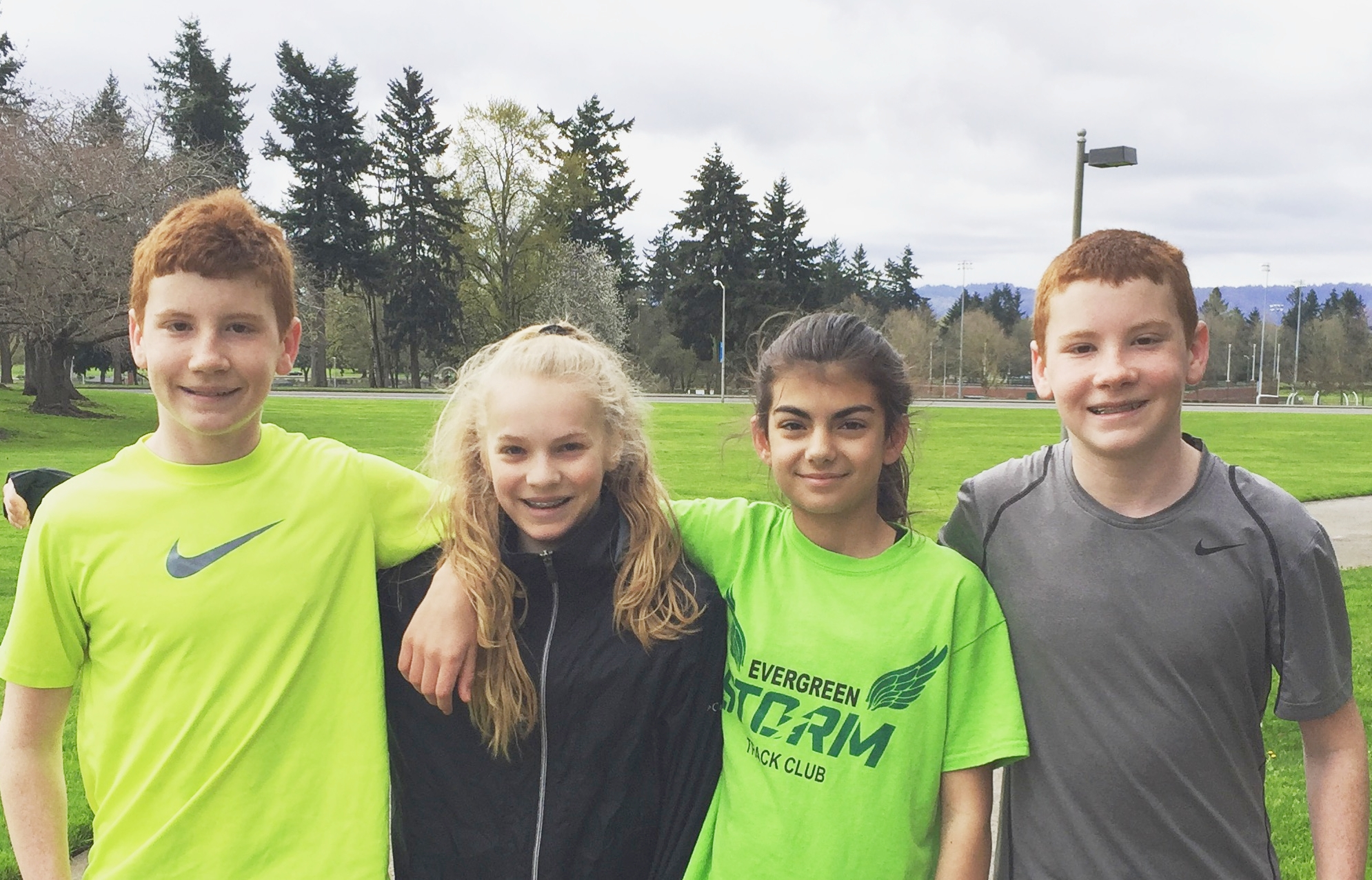 Okay, haha, very funny, Kiley's sporting an Evergreen Storm Running Club shirt. This was a little joke they played on Coach Dave, which captured the spirit of what Whisper Running is truly about - participating in a healthy hobby and having fun!