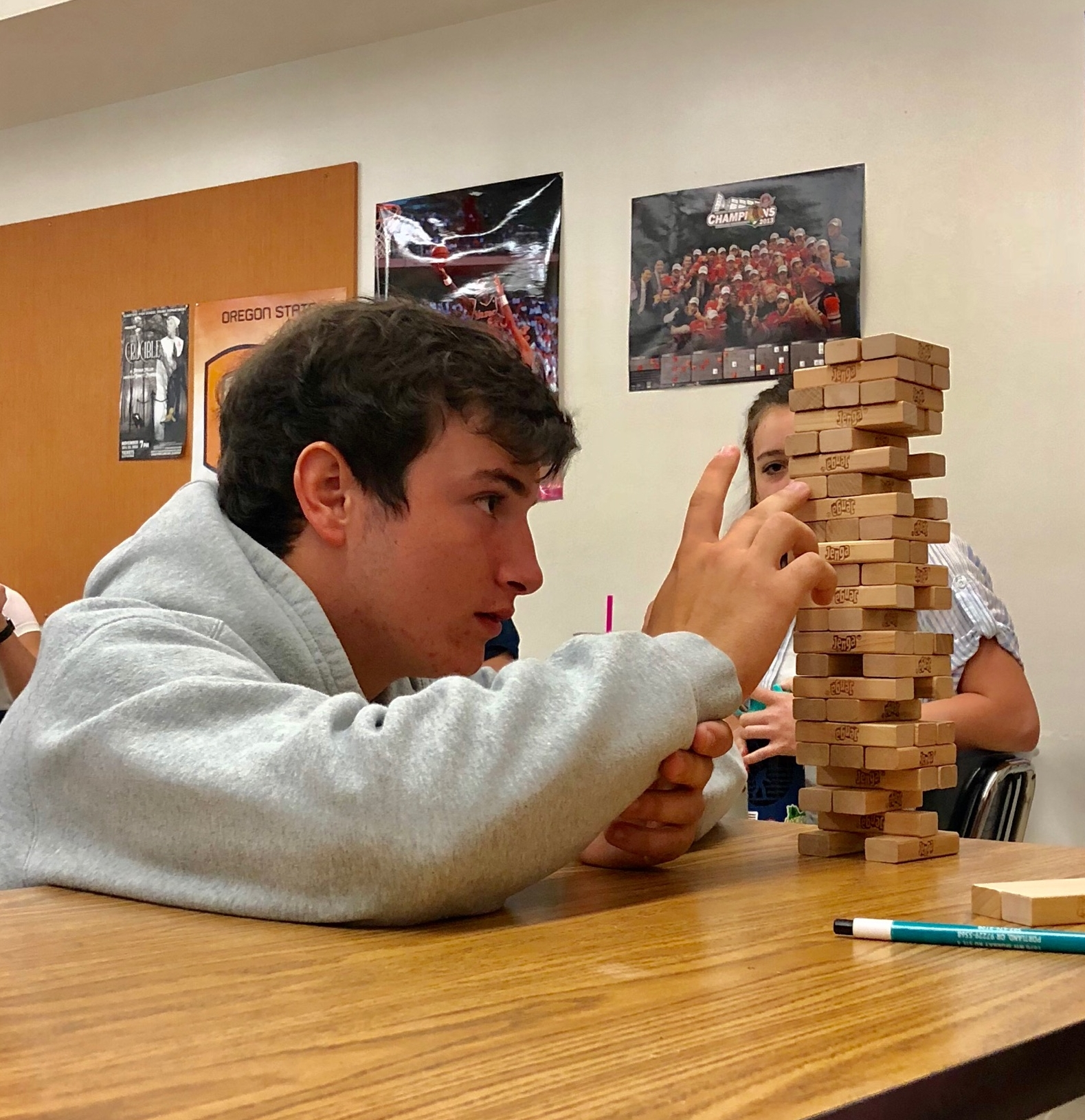 Concentration games such as Jenga can cuiltivate greater attention span and focus.  Keep games light and fun for maximal results.