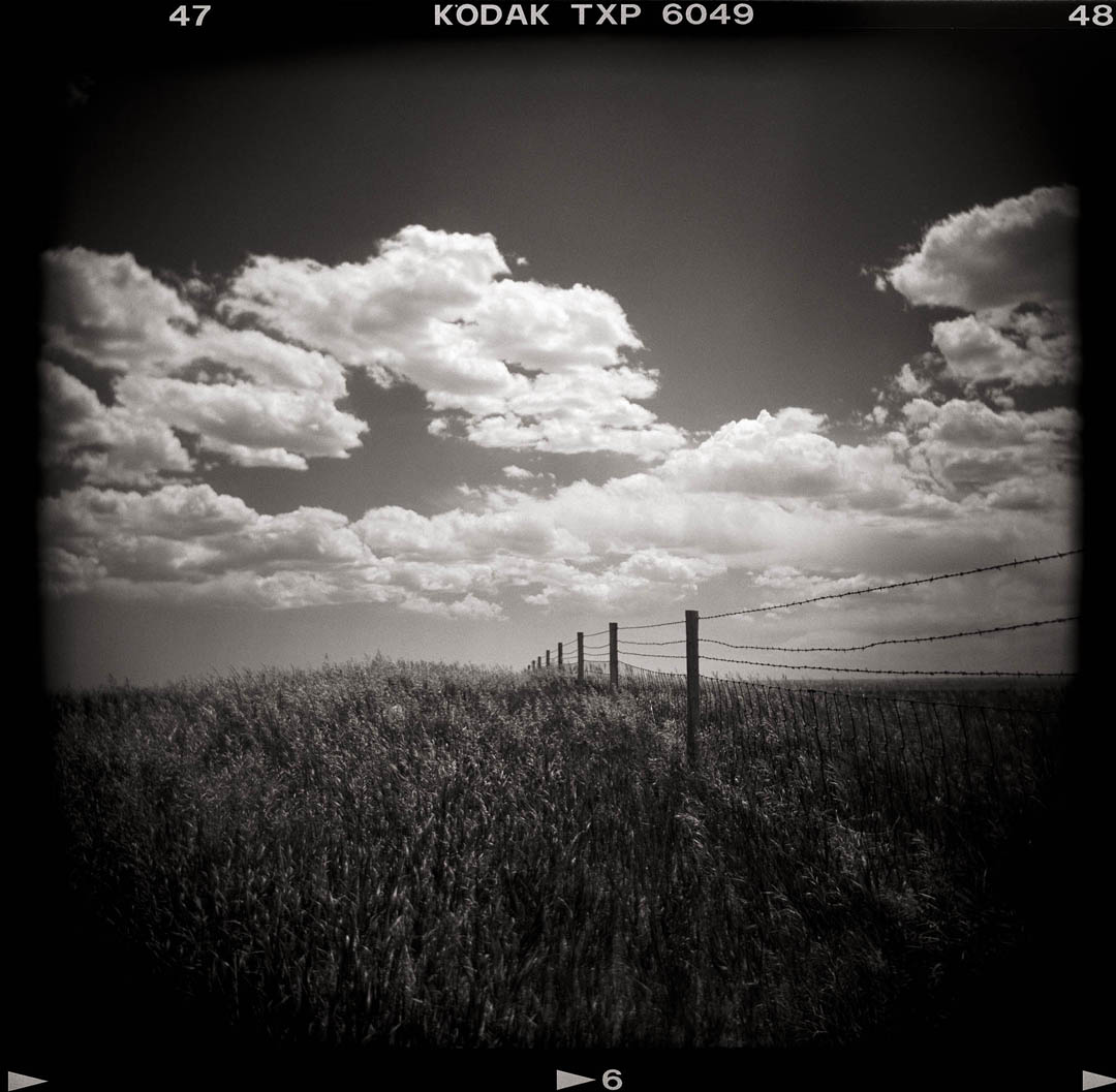 Fence and Clouds, Wyoming