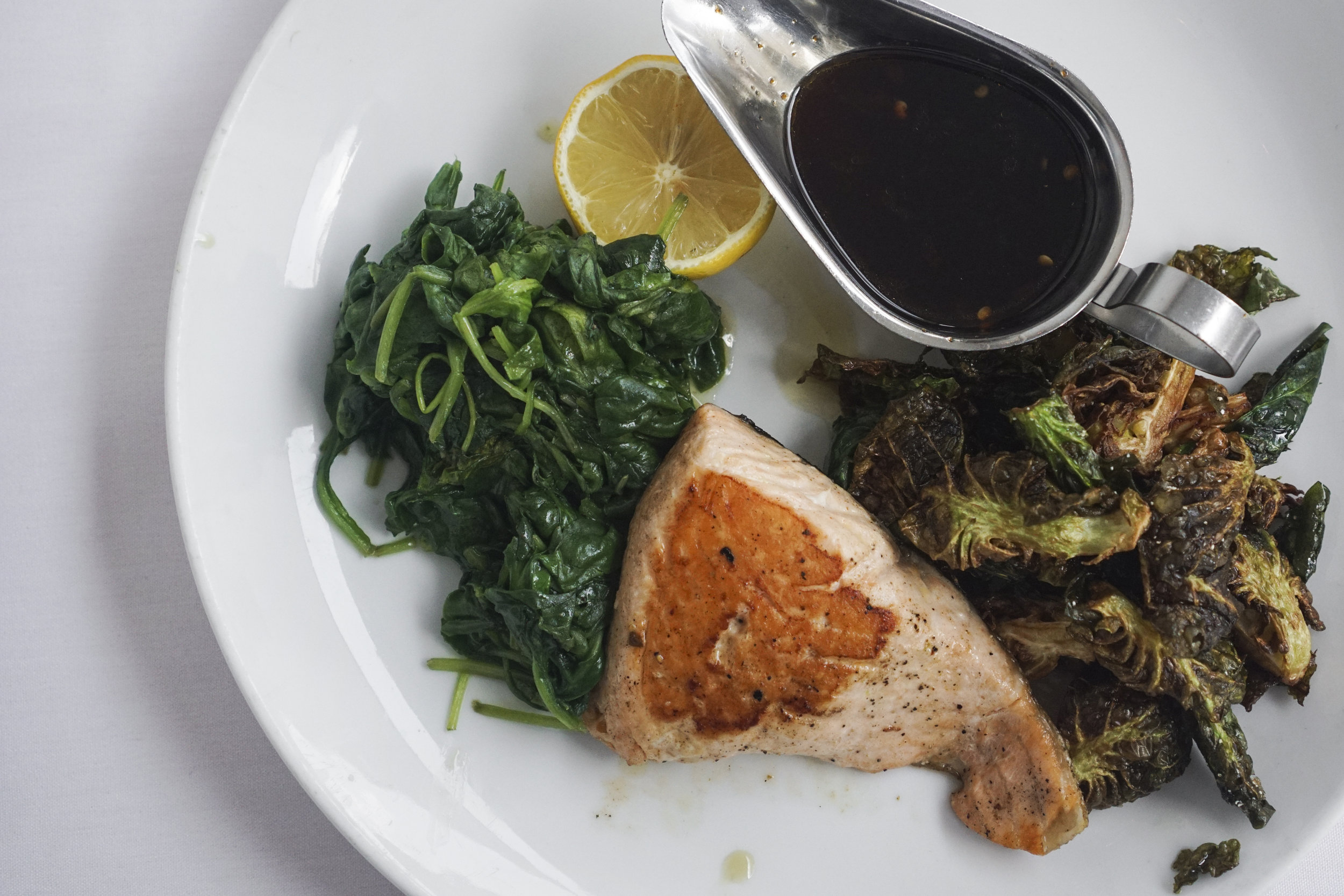 Scottish Salmon with soy chili glaze, sauteed spinach and brussel sprouts
