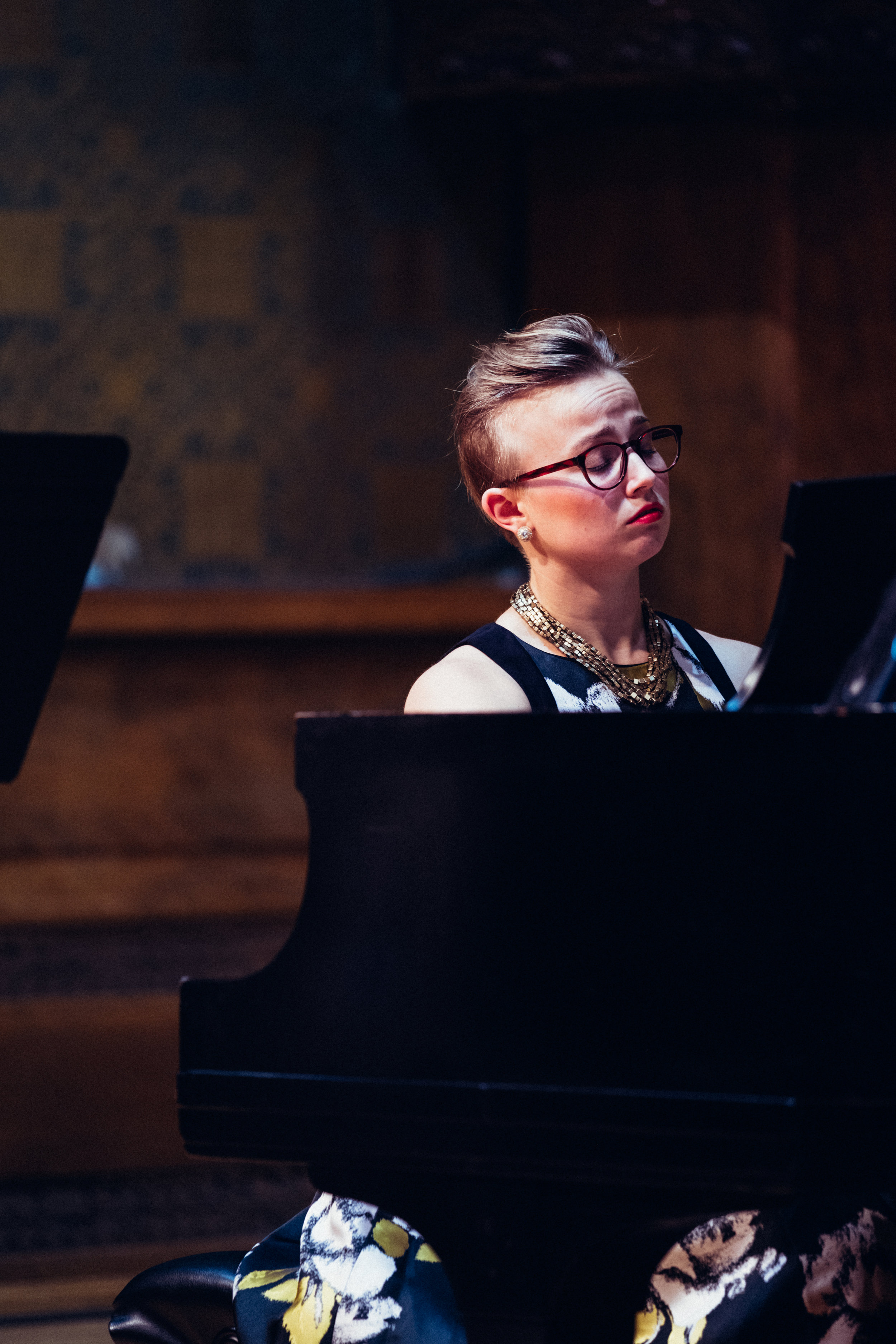 """Entrepreneur, activist, and musician, Elizabeth Newkirk encompasses thoughtfulness and artistry in all of her work, performances, and collaborations. She is the co-founding pianist of Bow & Hammer, her primary ensemble in which she serves as the Artistic Director. With Bow & Hammer, she explores her passion for duo repertoire of the early 20th century, while balancing it with new and standard works. Extremely inspired by the slow-food movement, she is dedicated to creating concerts that can mirror the thoughtfulness and thoroughness of the food movement, furthermore creating a relevancy for new audiences, meaningful experiences, and a camaraderie among other disciplines. """"IndustryNight"""" and """"Élevé ,"""" are just two examples of presentations by Bow & Hammer that feature a wide range of disciplines, artists, and small businesses in Chicago.  Newkirk is equally versed in duo collaboration with voice. Passionate about art song and opera, she is a collaborative pianist for the vocal department at the Chicago College of the Performing Arts. There, she serves as a staff pianist, vocal coach, and rehearsal pianist for recitals, opera rehearsals, and productions. With Bow & Hammer, other chamber ensembles, and mixed genres, she has premiered new works, performed with mixed media and multiple disciplines, supported new projects, and remains a part of a diverse network that includes traditional institutions as well as new organizations.  Growing up on her family farm in Indiana, Newkirk came to Chicago to pursue studies in Piano Performance. She received her MM from Roosevelt University with a minor in Collaborative Piano where she studied with Ludmila Lazar, Dana Brown and Angela Yoffe. Receiving her BA from Columbia College, she studied under pianist/composer Sebastian Huydts and jazz with Dennis Luxion. Additionally, she has had the privilege to work with Mary Sauer, Winston Choi, Cliff Colnot, and Sylvia Wang. Newkirk currently is on faculty at Columbia College Chicago. When"""