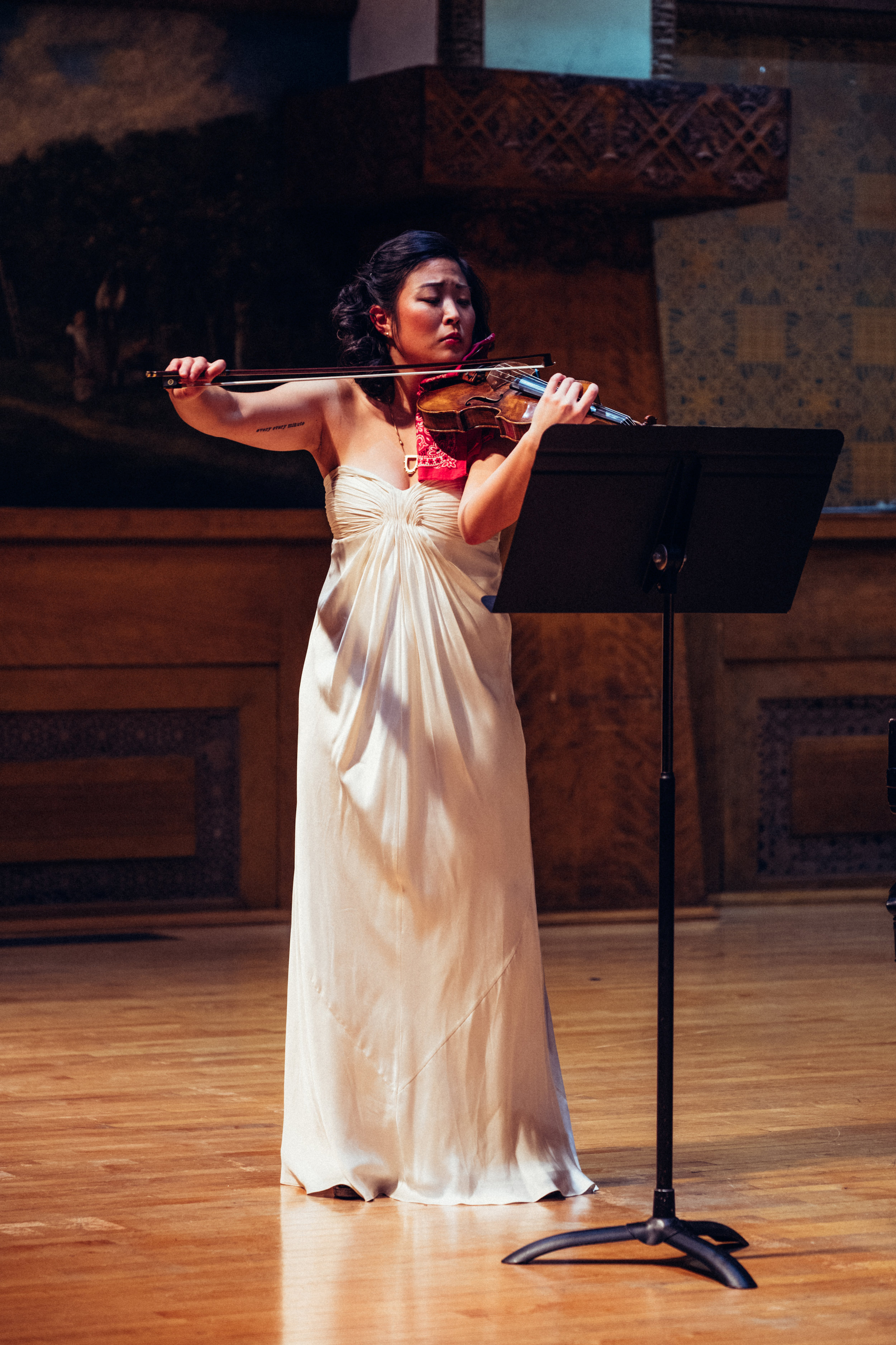 """Kathryn Satoh is impassioned by genuine and purposeful human connectivity, and uses these characteristics to drive her artistic career. Ms. Satoh is co-founder and violinist of her primary ensemble Bow & Hammer, curating new performance series which affirm the relevance of classical music in mainstream social interaction. Through their original concert series, """"Industry Night"""" and """"Élevé"""", BH has cultivated close collaborative relationships with other artists and small businesses and has held local and international residencies (Italy, Canada) to develop their communal mission. A collaborator to the core, she sees chamber music as a timeless manifestation of social progress.  Ms. Satoh jumps at any opportunity to alter her perception of being a musician. Trained as a vocalist and violinist, she has worked with theaters, opera companies, composers, poets, actors, and multi-disciplinary companies to premiere, preserve, or adapt works of diverse genres ranging from cabaret bar songs to large scale symphonic orchestral repertoire. These endeavors have put her on stage with Civic Orchestra of Chicago, Grant Park Music Festival Chorus, Third Eye Theater Ensemble, and Mozawa, among other artists and companies.  Highly regarding her value as a communicator and advocate for the arts, Ms. Satoh is an active teaching artist. She holds faculty and administrative positions at Naperville School of Performing Arts, and maintains a private violin studio throughout Chicagoland. With Bow & Hammer, she acts as a guest lecturer and collaboration coach, and has individually adjudicated various festivals and competitions.  Ms. Satoh holds two Bachelor of Music degrees with distinction from the University of Colorado in Violin and Voice Performance under the teaching of Lina Bahn (Corigliano Quartet) and Patrick Mason. In the rare spare moment, she loves to read/watch memoirs, eat home-cooked meals (made by herself or others; she is non-discriminant), be outdoors, and embark on adventures"""