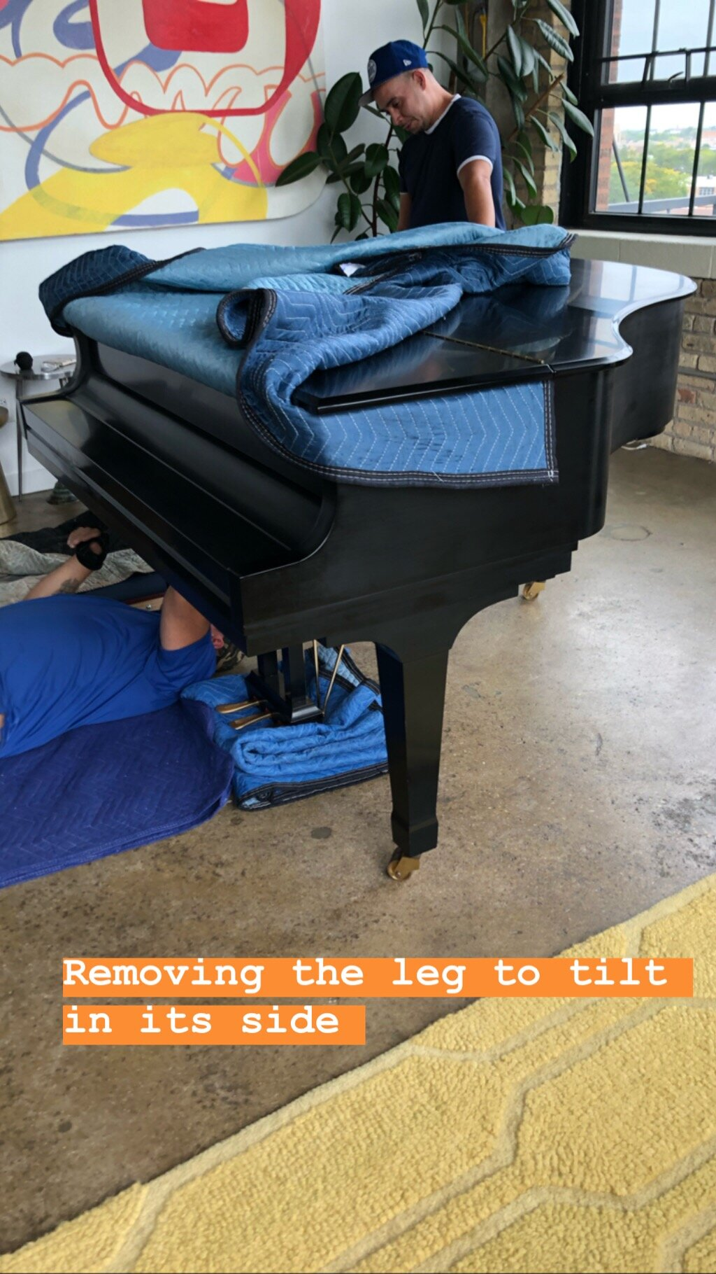 Starting with the 5'4''. They remove the left top leg first to safely tilt the piano on its side.