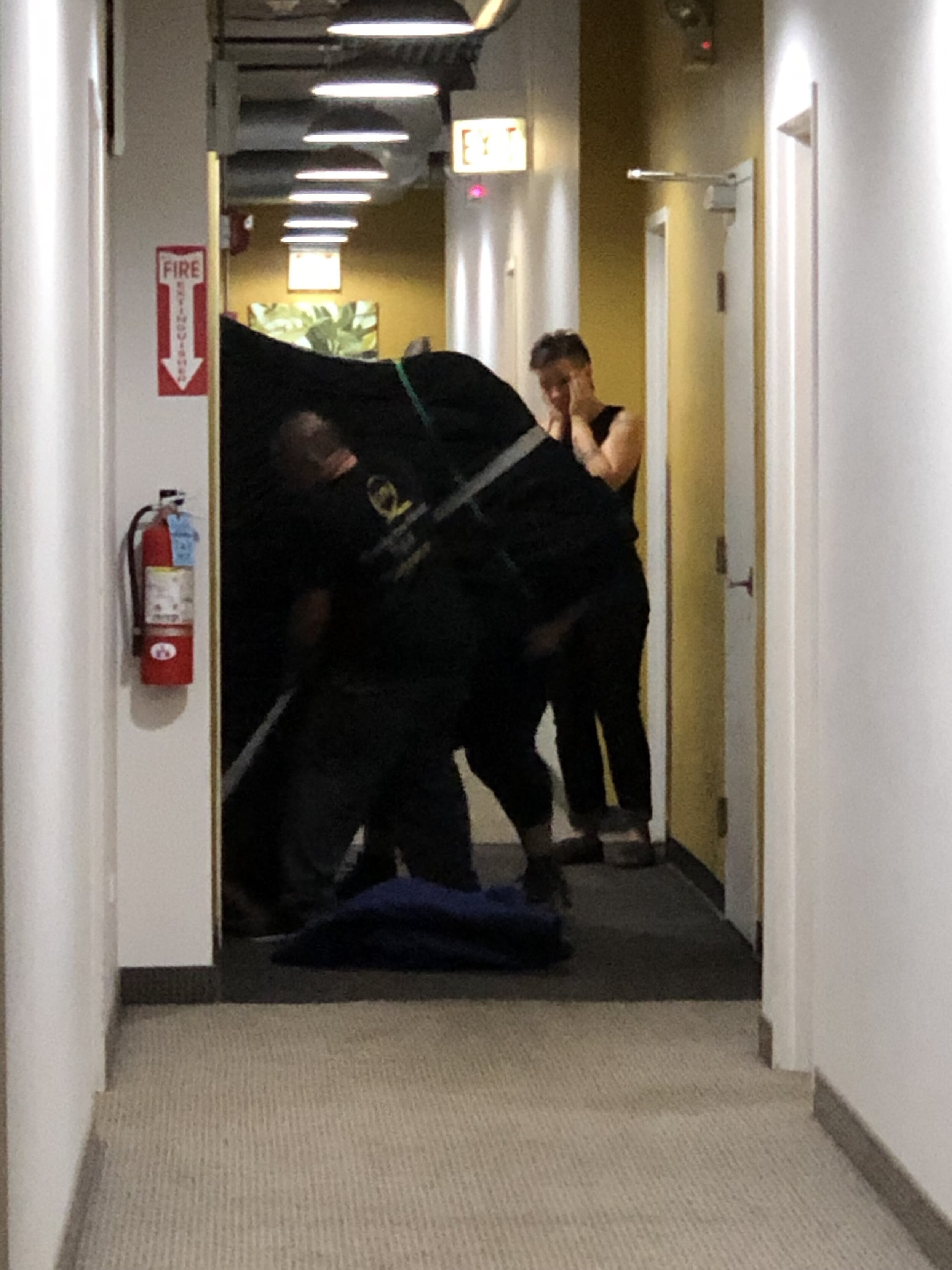 Turns out, the Boston 215 is about 500lbs heavier than its Steinway B counterpart. These guys were having to lift and inch it out of the elevator. Christa's face says it all.