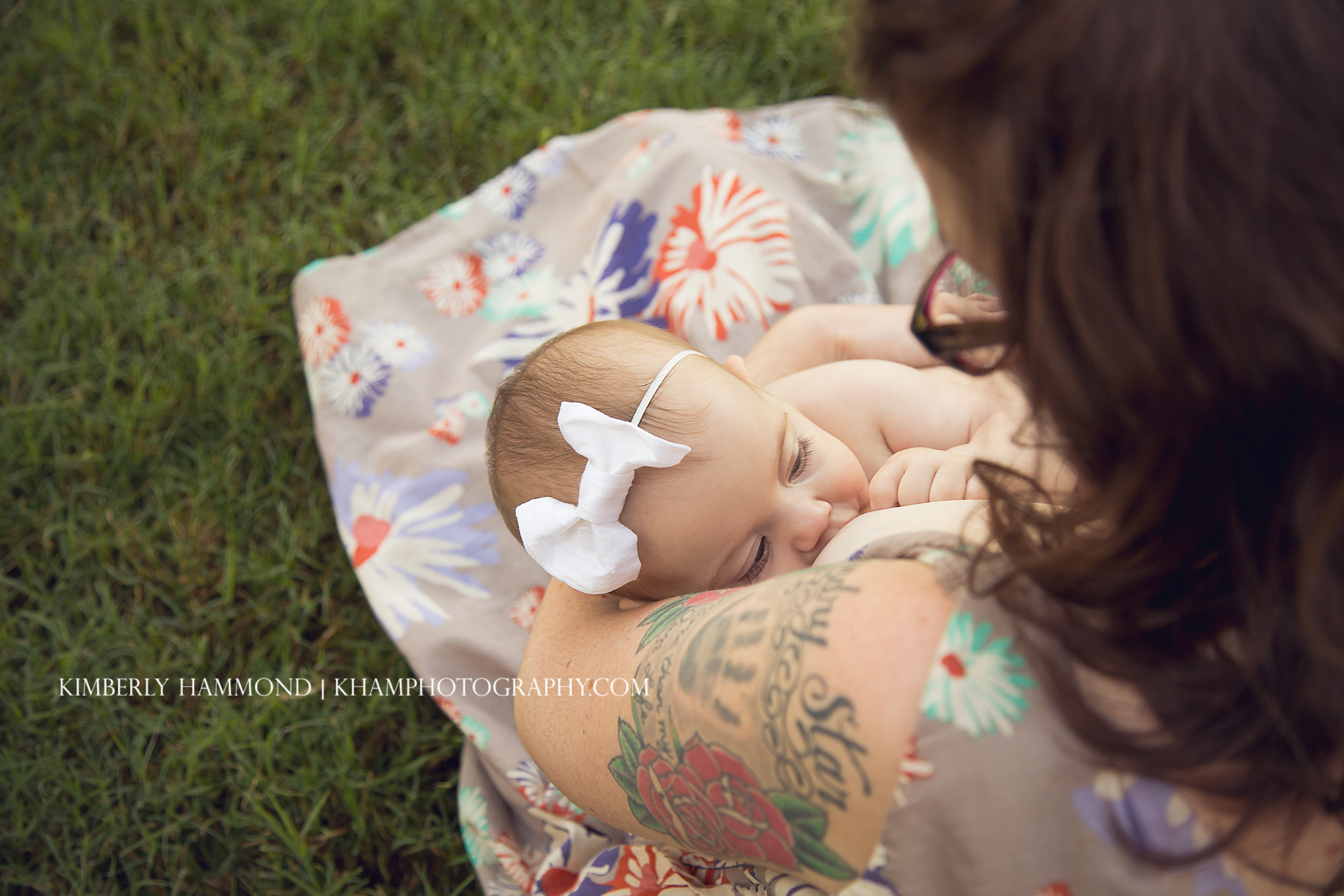 Baby breastfeeds at park in Frisco, TX.