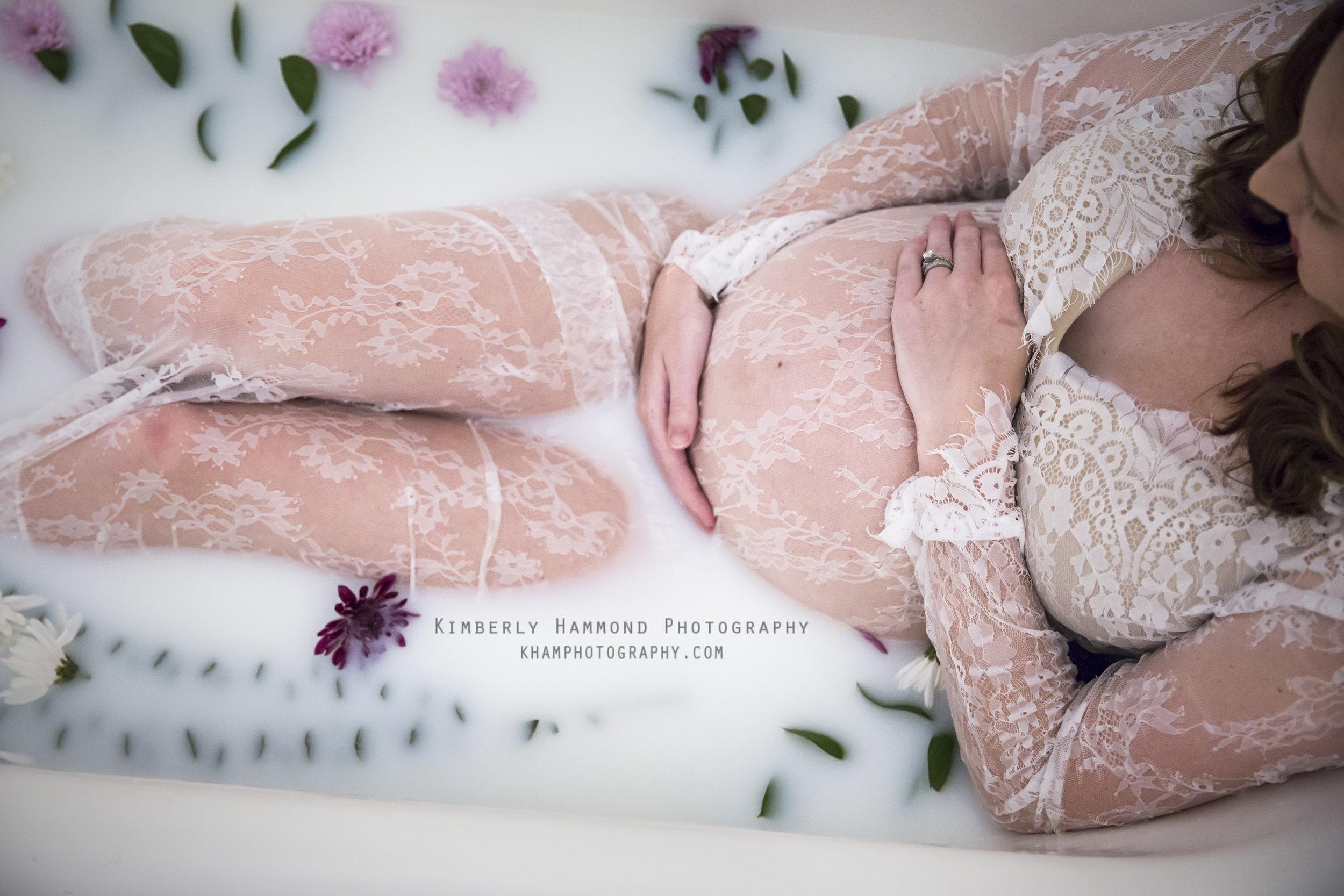 Pregnant mom soaks in floral milk bath in Bedford TX.