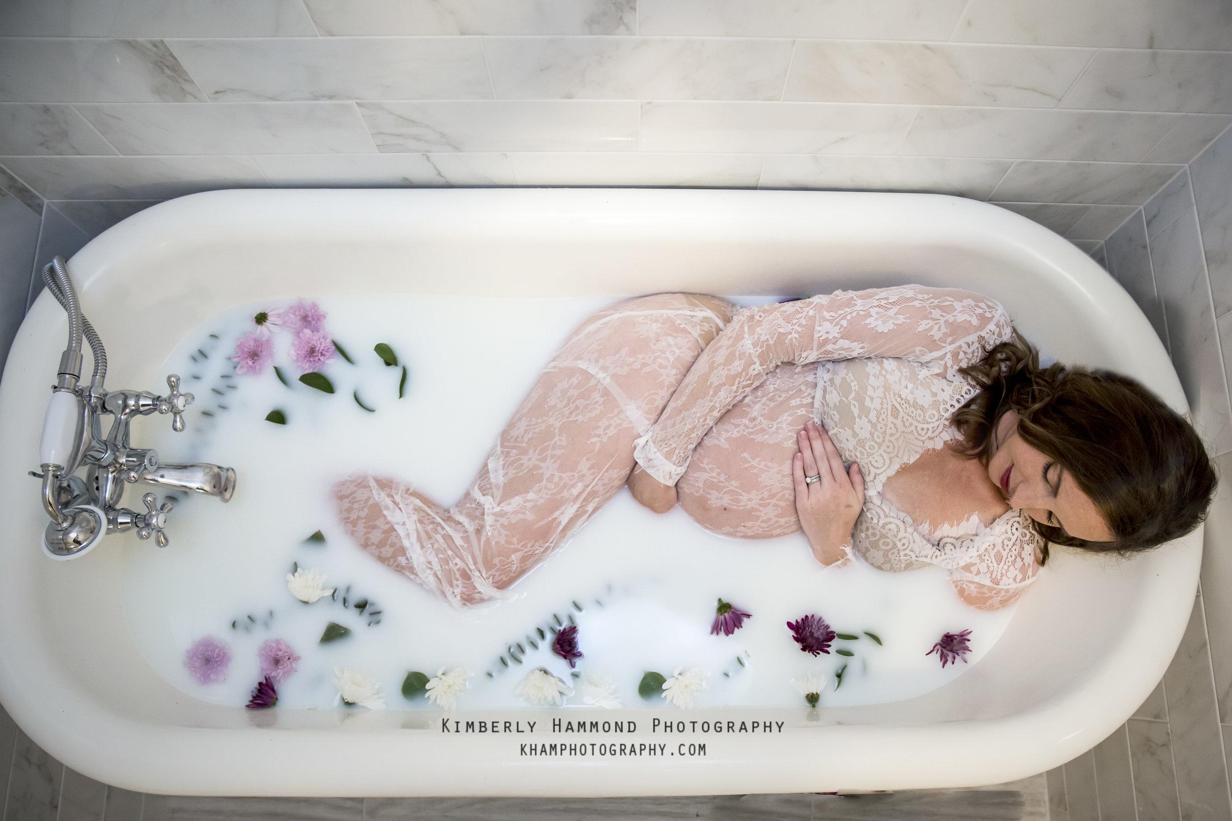 Pregnant woman soaks in a floral milk bath in Bedford, TX.