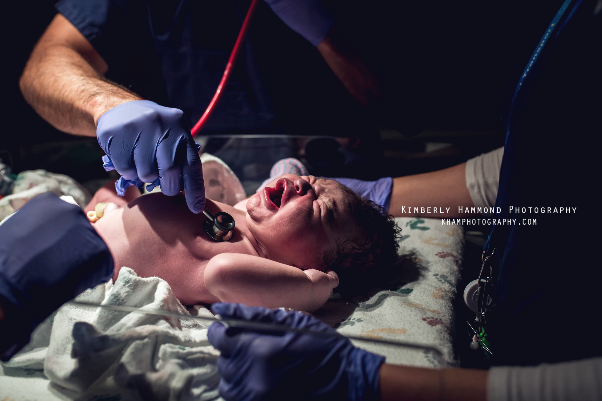 Newborn is examined after birth at Baylor Medical Center in Dallas, TX.
