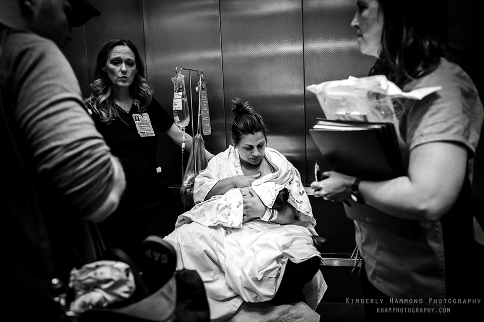 The moment time stood still. Everything was carrying on around her but she was soaking in her new baby. Dallas birth photography, DFW birth photography