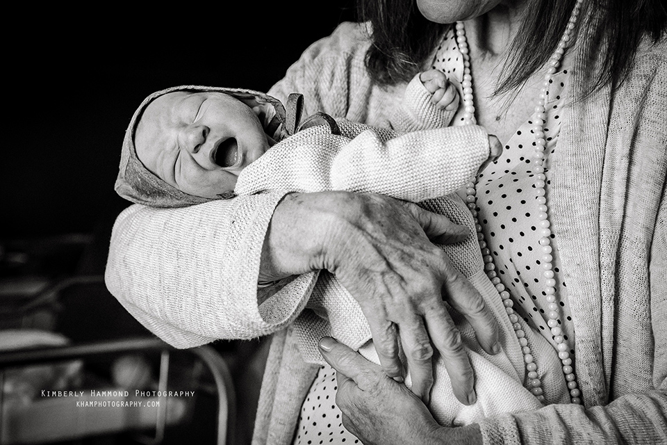 Newborn stretches after birth at Baylor Medical Center in Dallas TX.