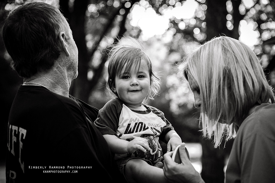 Grandparents hold grandson while camping in Grand Prairie, TX.
