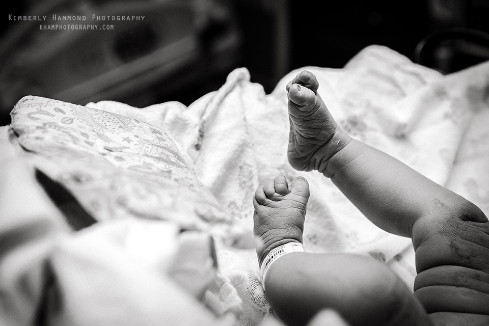 Brand new baby feet at natural hospital birth in Grapevine TX.