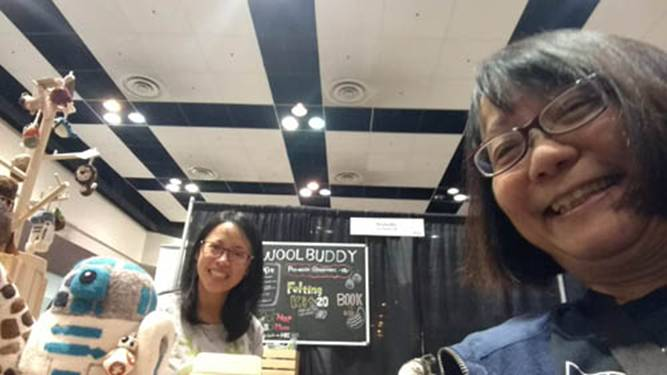 """Here I am with the owner of """"Wool Buddy"""" at her booth. She and her husband sell many needle felting supplies as well as cute finished projects."""