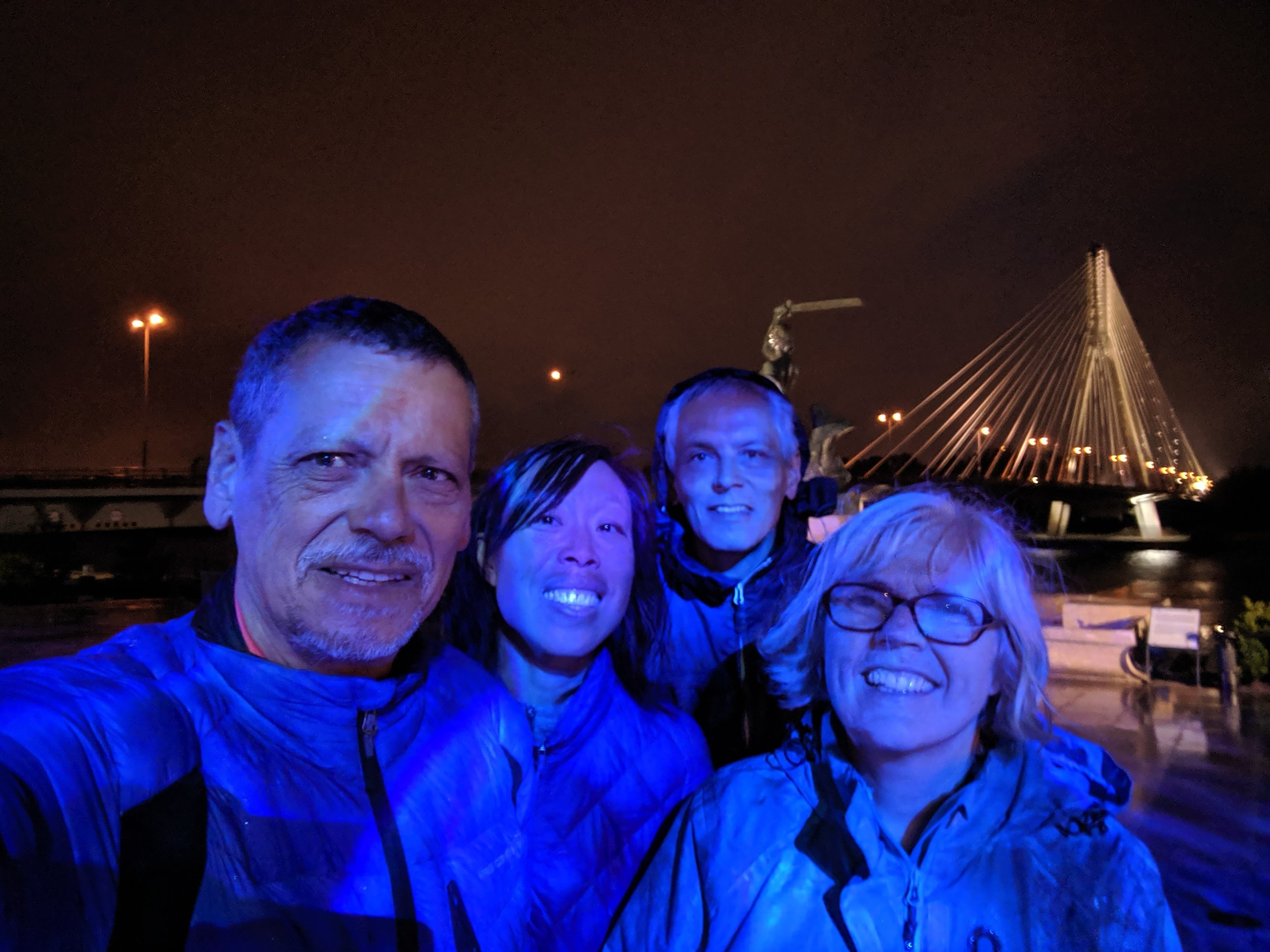 Wet evening after we arrived in Warsaw — Mark, Andrea, Chris and Sarah, by the Vistula (Wiswa) River.