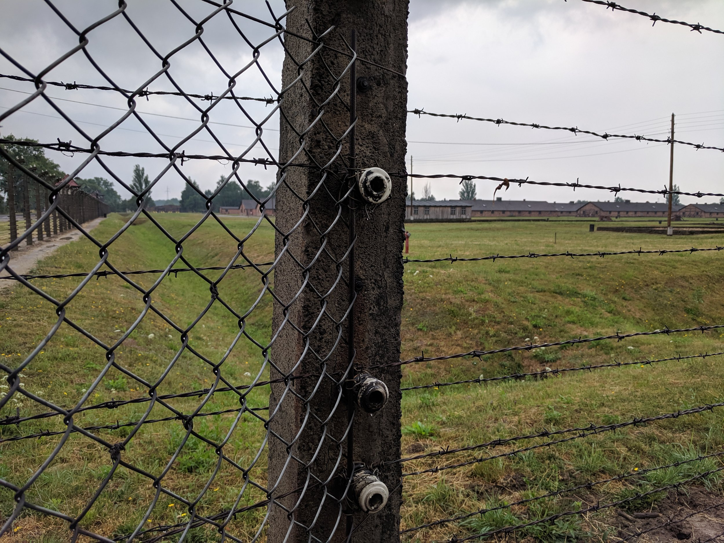 Remains of Birkenau, surrounded by electric barbed wire fences, the largest Death Camp of the Third Reich.