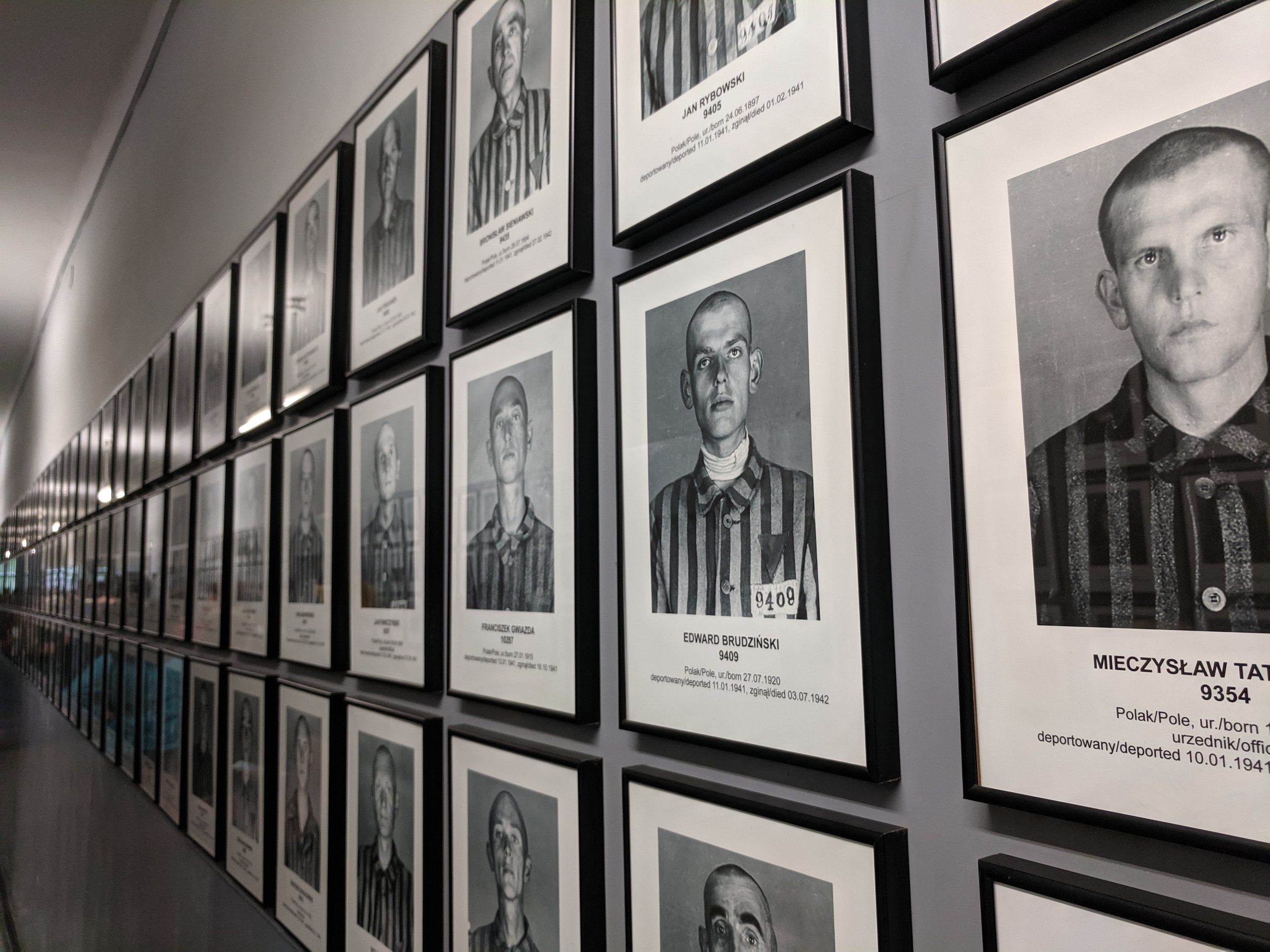 At Auschwitz (and every death camp): each internee was robbed of identity, issued uniform striped pyjamas in place of all clothes and belongings, heads shaved (men and women), called by number instead of a name.