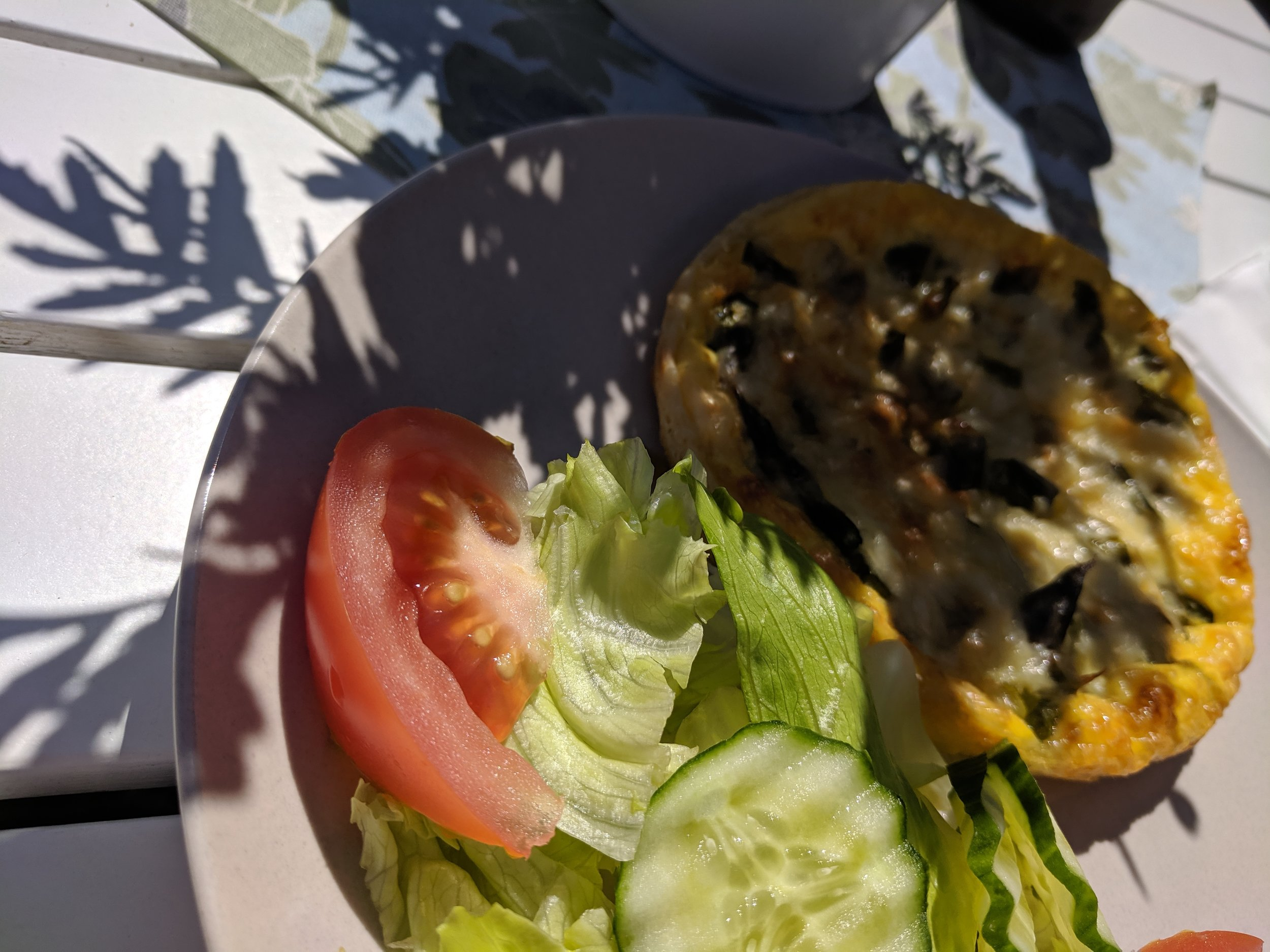 Homemade Mushroom Quiche and salad outside the town of Tofta on Gotland, Sweden.