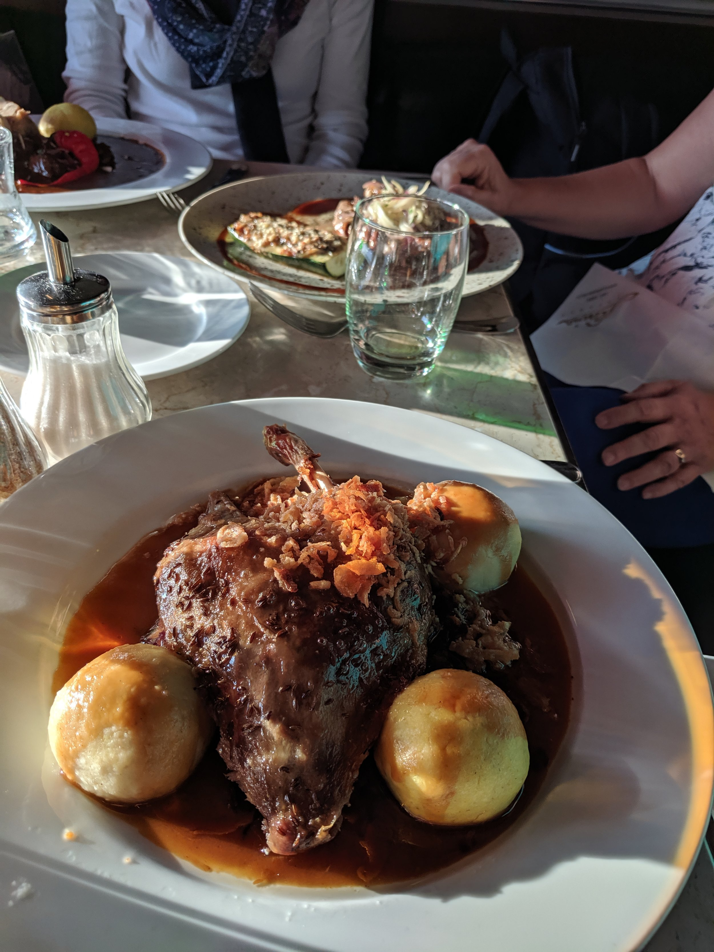 Roast duck topped with baked garlic slices, and Dumplings in duck sauce … in Prague.