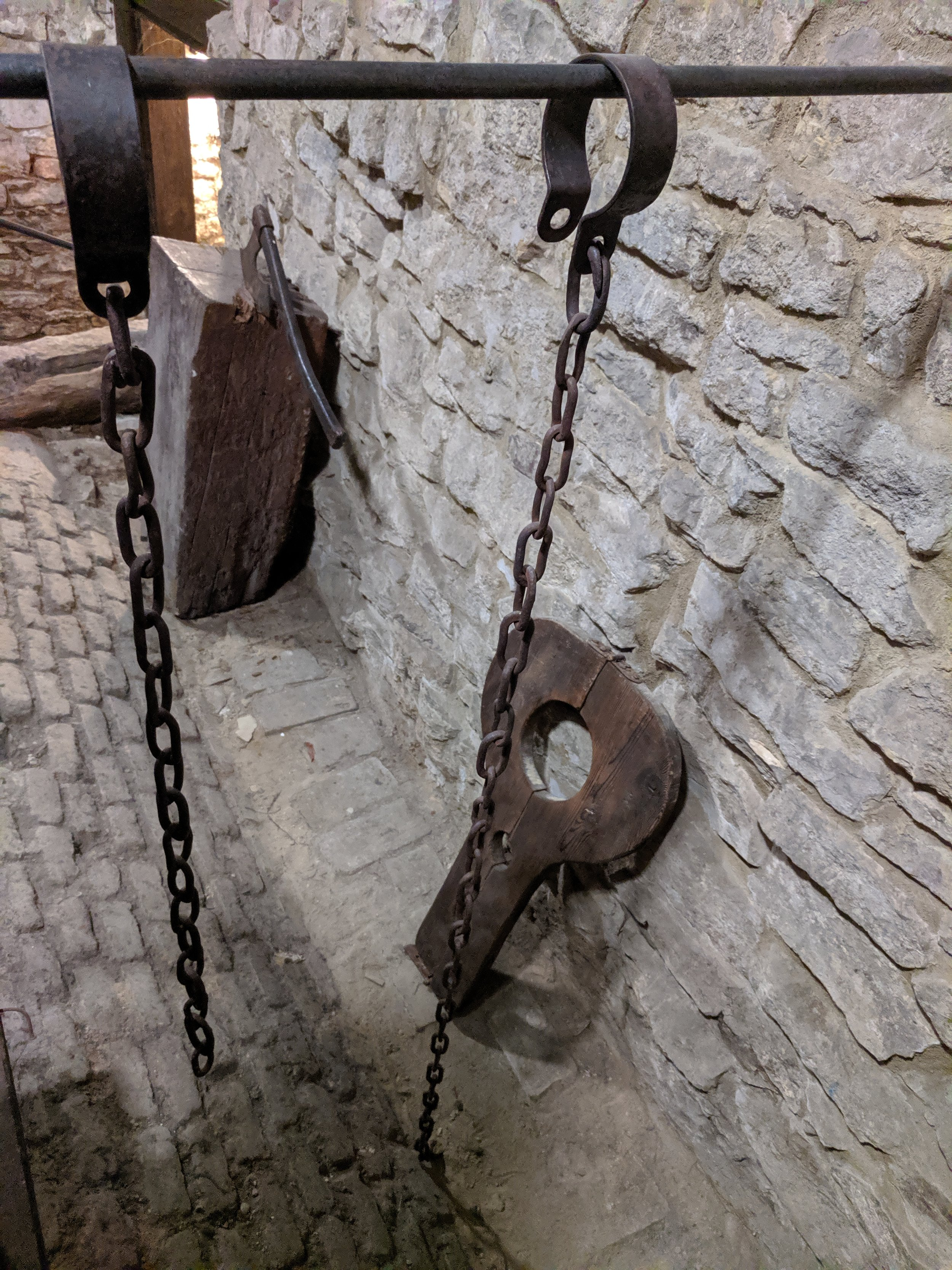 Prison under Prague Town Hall and original implements used for penal punishment in the era of Jan Hus.
