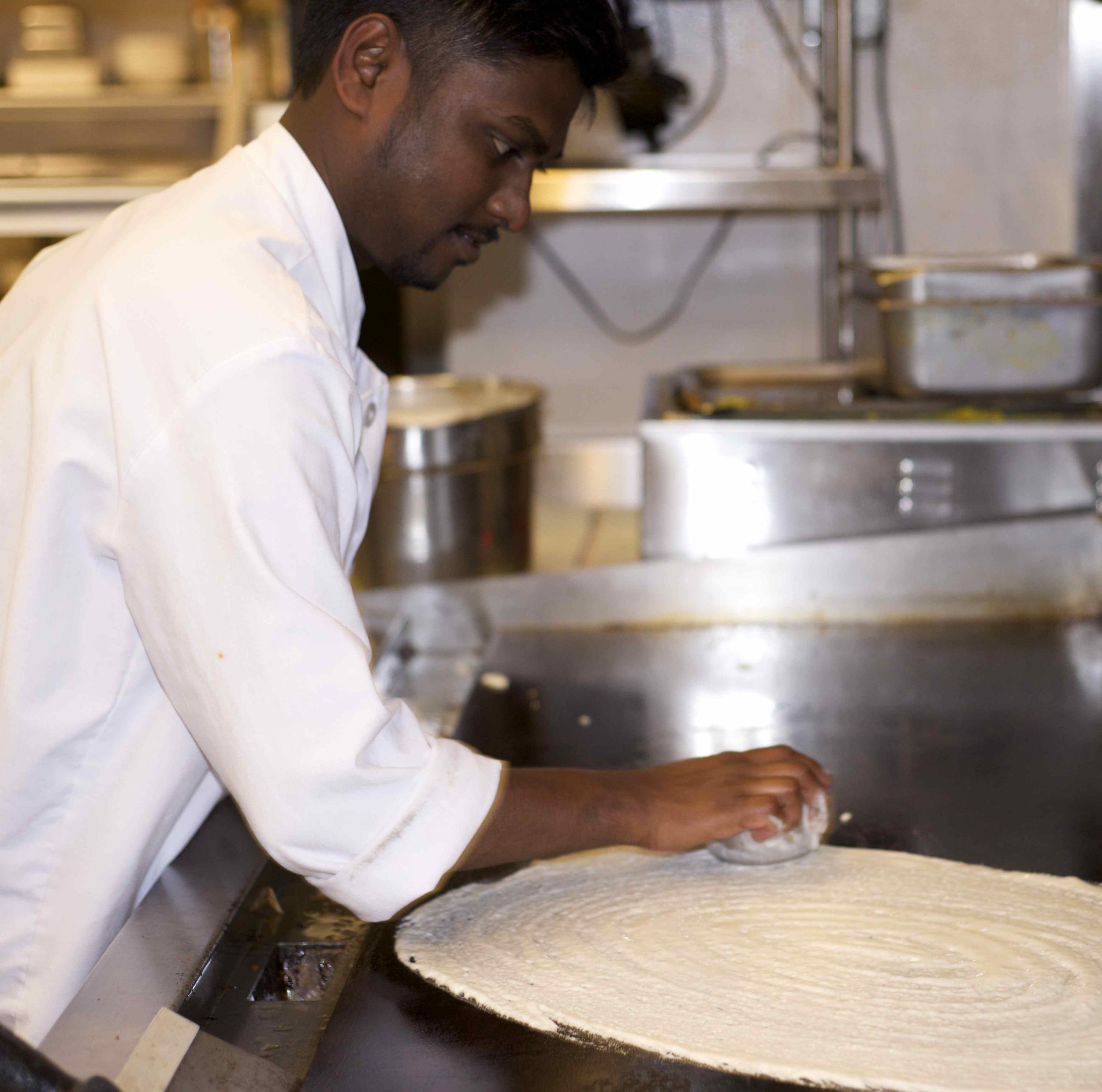 Chef Vijay Kumar demonstrating Dosa's specialty dish - the dosa.
