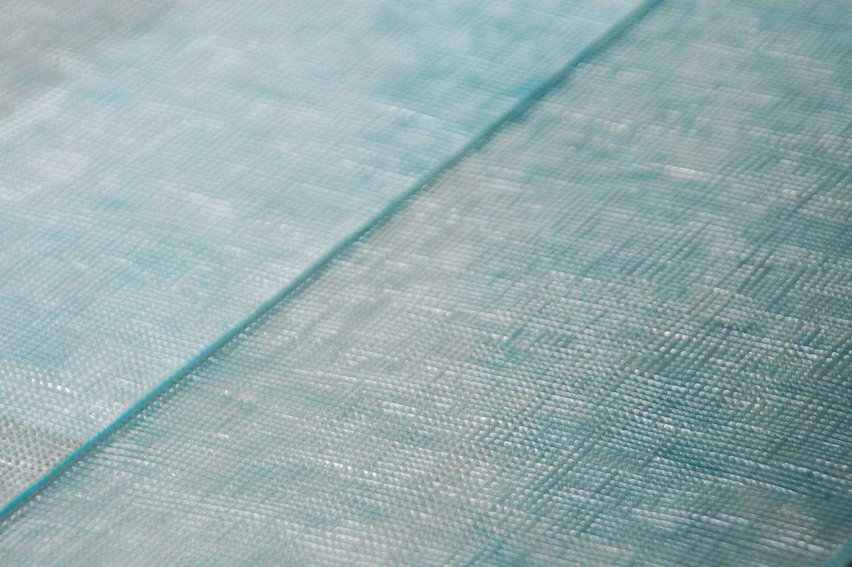 Glass cladding by Studiosilice