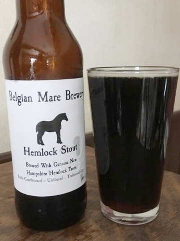 HEMLOCK STOUT: A dark, robust cream stout flavored with the addition of NH hemlock tree tips.